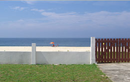 Marica Beach House - front gate to the beach